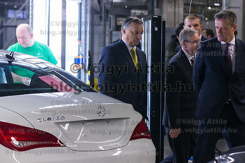 Viktor Orban (C) prime minister of Hungary visits the Mercedes-Benz factory in Kecskemet, (about 100 km south of Budapest), Hungary on January 20, 2015. ATTILA VOLGYI