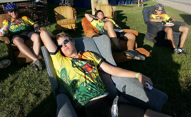 """This is the most comfortable I've been all week,"" RAGBRAI rookie Michael Hart of Des Moines, front, says while relaxing with his family in recliners in Colo.  Behind him are his father, Brian, and brothers Josh and Aaron."