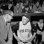 Pittsburgh PA:  Public Relations man Bill Wilde talking with all-time great Pie Trainor in the dugout at the HYPO charity baseball game with the Cleveland Indians - 1964.<br /> The money raised by HYPO (Help Young Players Organize) was used to help local communities buy equipment and build ball fields