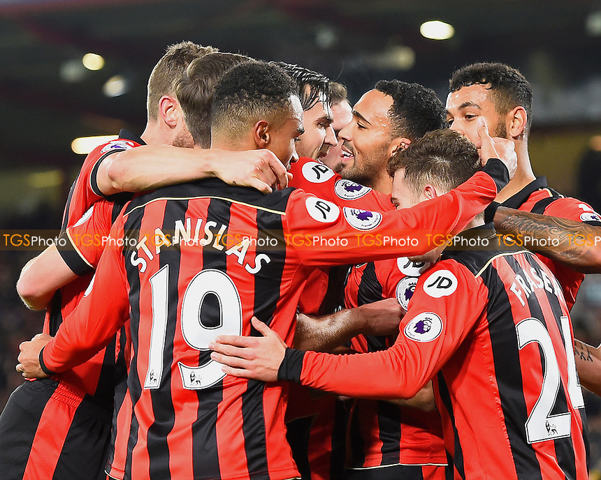 Callum Wilson of AFC Bournemouth is mobbed after scoring the second goal during AFC Bournemouth vs Arsenal, Premier League Football at the Vitality Stadium on 3rd January 2017