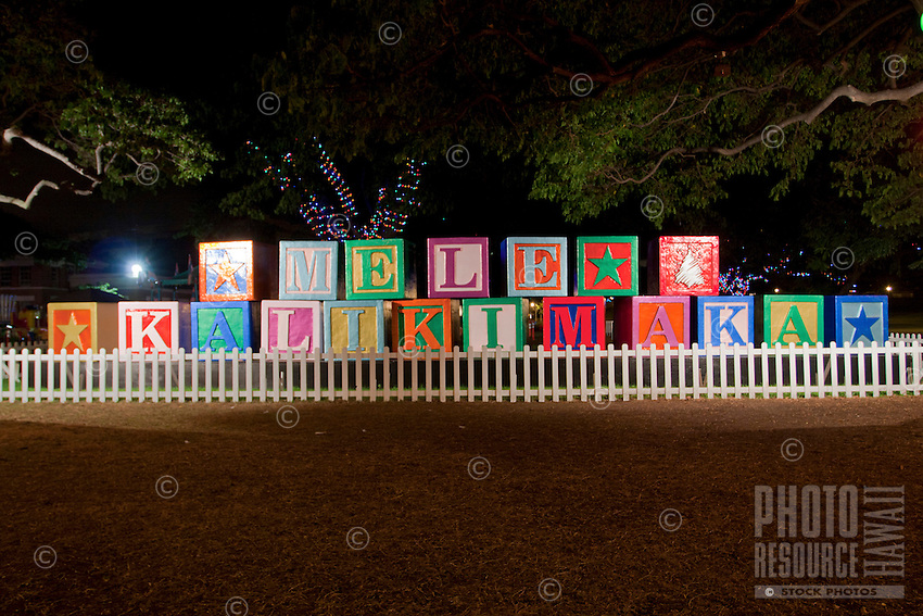 """""""Mele Kalikimaka"""" spelled out in giant children's building blocks means """"Merry Christmas"""" to all visiting the Honolulu Hale courtyard at the annual Christmas tree lighting attraction, downtown Honolulu, O'ahu."""