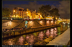 France, Paris.  <br /> If you don't have a tripod, hold onto the camera strap, then rest your camera on something solid like a guardrail. Put the shutter on a timer for even less vibration, especially for a longer exposure.  Visitors along the Seine River at night.