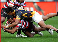 Wellington's Julian Savea tackles David Raikuna. ITM Cup - Wellington Lions v Counties-Manukau Steelers at Westpac Stadium, Wellington, New Zealand on Sunday, 8 August 2010. Photo: Dave Lintott/lintottphoto.co.nz.