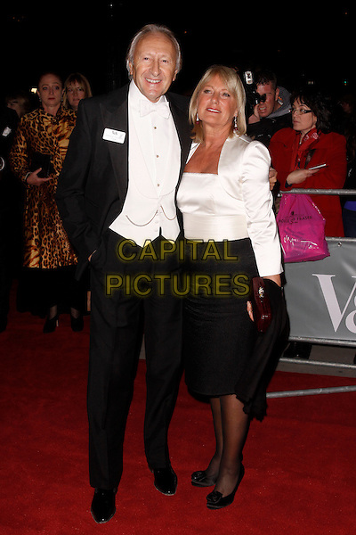 Harold Tillman & guest.Hollywood Costume - Gala Dinner, Victoria and Albert Museum, London, England. .October 16th, 2012.full length black white suit waistcoat top skirt blouse .CAP/AH.©Adam Houghton/Capital Pictures.
