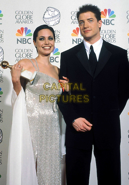 ANGELINA JOLIE & BRENDAN FRASER..Ref:043..golden globe award, one shoulder, short cropped hair, silver dress, silver, half lenghm half-length..www.capitalpictures.com..sales@capitalpictures.com..©Capital Pictures