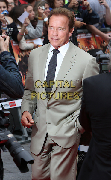 Arnold Schwarzenegger.'The Expendables 2' UK film premiere held at the Empire Leicester Square,.London, England..13th August 2012.half length beige suit black tie white shirt .CAP/ROS.©Steve Ross/Capital Pictures.