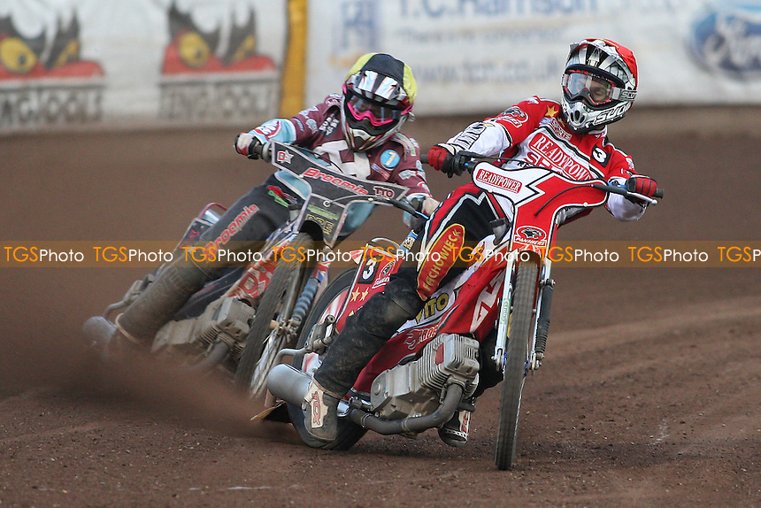 Heat 12: Norbert Kosciuch (red) ahead of Rob Mear - Peterborough Panthers vs Lakeside Hammers - Elite League Speedway at the Showground, Peterborough - 18/07/11 - MANDATORY CREDIT: Gavin Ellis/TGSPHOTO - Self billing applies where appropriate - 0845 094 6026 - contact@tgsphoto.co.uk - NO UNPAID USE.