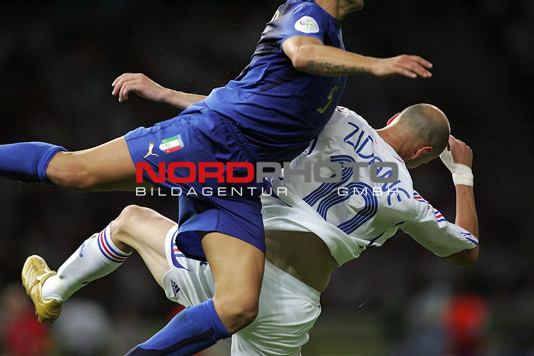 FIFA WM 2006 - Final / Finale<br /> <br /> Play #64 (09-Jul) - Italy vs France.<br /> <br /> Fabio Cannavaro (l) from Italy and Zinedine Zidane (r) from France fight for the ball during the match of the World Cup in Berlin.<br /> <br /> Foto &copy; nordphoto