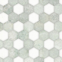 Hex, a waterjet stone mosaic, shown in polished Ming Green and Thassos, is part of the Semplice™ collection for New Ravenna.