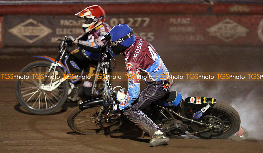 Heat 9: Stuart Robson (blue) with engine failure and Peter Karlsson (red) - Lakeside Hammers vs Coventry Bees, Elite League Speedway at the Arena Essex Raceway, Pufleet - 10/09/12 - MANDATORY CREDIT: Rob Newell/TGSPHOTO - Self billing applies where appropriate - 0845 094 6026 - contact@tgsphoto.co.uk - NO UNPAID USE.