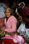 At Mommy's family home her best friend Fatmata cries as friends and family gather to mourn and see the baby on the day she died. ..Mommy delivered and died from postpartum bleeding at the PCMH (Princess Christian Memorial Hospital). Freetown, Sierra leone.