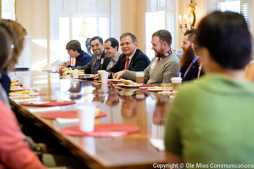 Jeff Vitter, who will start his new job as UM chancellor in January, visits with students over breakfast. Photo by Robert Jordan/Ole Miss Communications