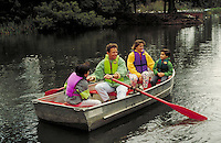 Family rowing a boat on Stow Lake in Golden Gate Park, San Francisco. San Francisco, California.
