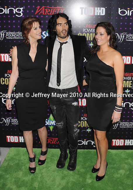LOS ANGELES, CA. - December 04: Noreen Fraser of the Noreen Fraser Foundation, Russell Brand and Michelle McBride, V. P. of The Noreen Fraser Foundation arrive at Variety's Power of Comedy presented by Sims 3 in Partnership with Bing at Club Nokia on December 4, 2010 in Los Angeles, California.