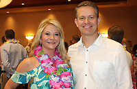 NWA Democrat-Gazette/CARIN SCHOPPMEYER Brandy and John Furner, Spring Fling honorary host, welcome guests to the Open Avenues benefit May 20 at the Embassy Suites in Rogers.