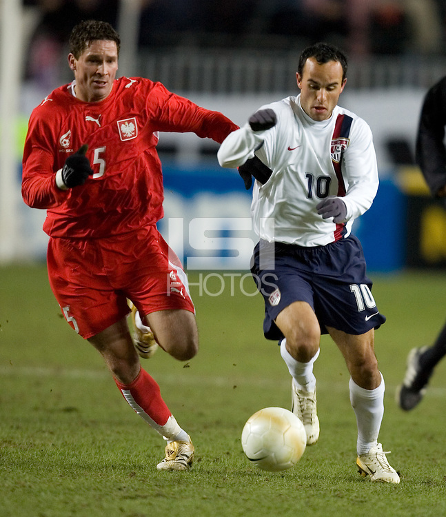 Landon Donovan fends off Poland's Arkadiusz Radomski at Fritz-Walter Stadium, Kaiserslautern, Germany, Wednesday, March 1, 2006. USA 1-0.