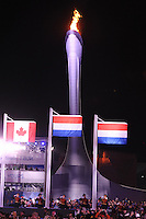 OLYMPICS: SOCHI: Medal Plaza, 13-02-2014, medaille uitreiking, 1000m Men, Olympische vlam en vlaggen, ©foto Martin de Jong