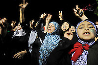 Women and children sing as they celebarte at Martyrs' Square in Tripoli. After a six month revolution, rebel forces finally managed to break into Tripoli and have taken control of Bab al-Aziziyah, Col Gaddafi's compound and residence. Few remain that are loyal to Gaddafi in the city; it is seeming that the 42 year regime has come to an end. Gaddafi is currently on the run.