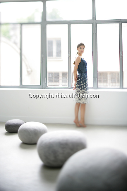 woman in a room with stones