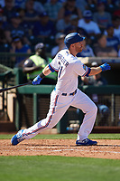 Todd Frazier (21) of the Texas Rangers follows through on a swing during a Cactus League Spring Training game against the Los Angeles Dodgers on March 8, 2020 at Surprise Stadium in Surprise, Arizona. Rangers defeated the Dodgers 9-8. (Tracy Proffitt/Four Seam Images)