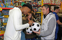 Pictured: Leroy Fer signs a football Wednesday 08 December 2016<br />Re: Swansea City FC players have bought Christmas gifts for 60 children at Smyths toy store in Swansea, south Wales.