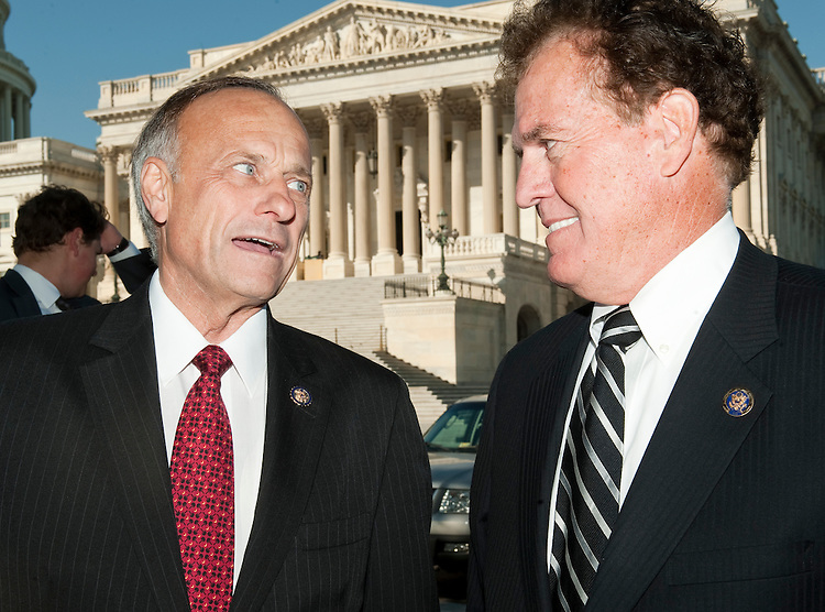 UNITED STATES - OCTOBER 5: Rep. Steve King, R-Iowa, left, talks with Rep. Phil Gingrey, R-Ga., before the start  of the news conference at the Capitol on Wednesday, Oct. 5, 2011, to accept over 1.6 million petitions from American citizens who are urging Congress to immediately repeal Patient Protection and Affordable Care Act. (Photo By Bill Clark/CQ Roll Call)