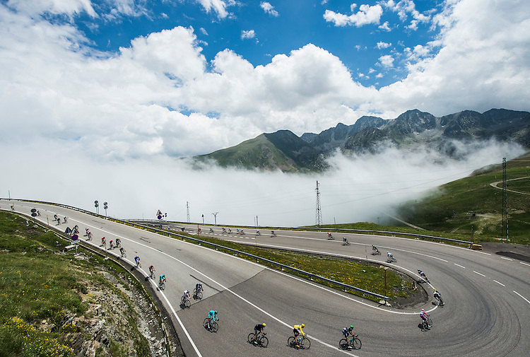 Picture by Alex Broadway/ASO/SWpix.com - 12/07/16 - Cycling - Tour de France 2016 - Stage Ten - Escaldes-Engordany to Revel - The peloton descends from Port d'Envalira.<br /> NOTE : FOR EDITORIAL USE ONLY. COMMERCIAL ENQUIRIES IN THE FIRST INSTANCE TO simon@swpix.com THIS IS A COPYRIGHT PICTURE OF ASO. A MANDATORY CREDIT IS REQUIRED WHEN USED WITH NO EXCEPTIONS to ASO/ALEX BROADWAY