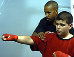 Patrick Day, 14, of Freeport, gives advice on boxing stance to Michael Florio, 12, of Oceanside, at the Freeport Police Athletic League Gym in Northeast Park in Freeport on Wednesday,  January 24, 2007. (Photo / Jim Peppler).