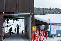 Skiiers get on the Payload triple chair at Showdown Ski Area on King's Hill in the Little Belt Mountains near Neihart, Montana, USA.
