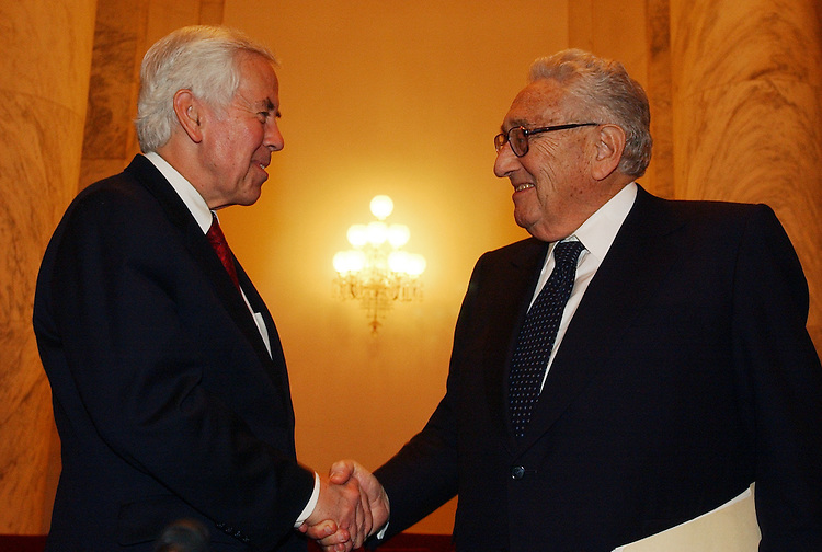 Sen. Dick Lugar, R-Ind., right, greets former Secretary of State Henry Kissinger, before a Senate Foreign Relations Committee hearing discussing the Middle East Road Map.