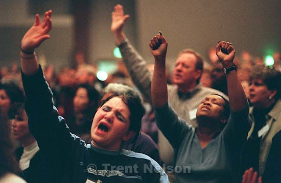 Darby Nelson praises God at a Penecostal meeting Thursday night at Judge High School.<br />