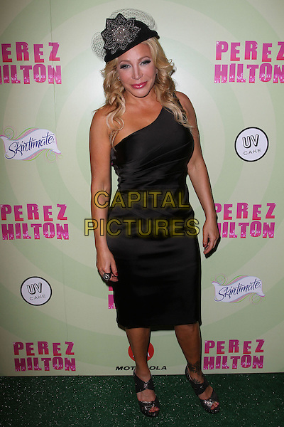 Taylor Dayne.Perez Hilton's Mad Hatter Tea Party Birthday Celebration Held at Siren Studios, Hollywood, California, USA..March 24th, 2012.full length black one shoulder dress hat.CAP/ADM/KB.©Kevan Brooks/AdMedia/Capital Pictures.