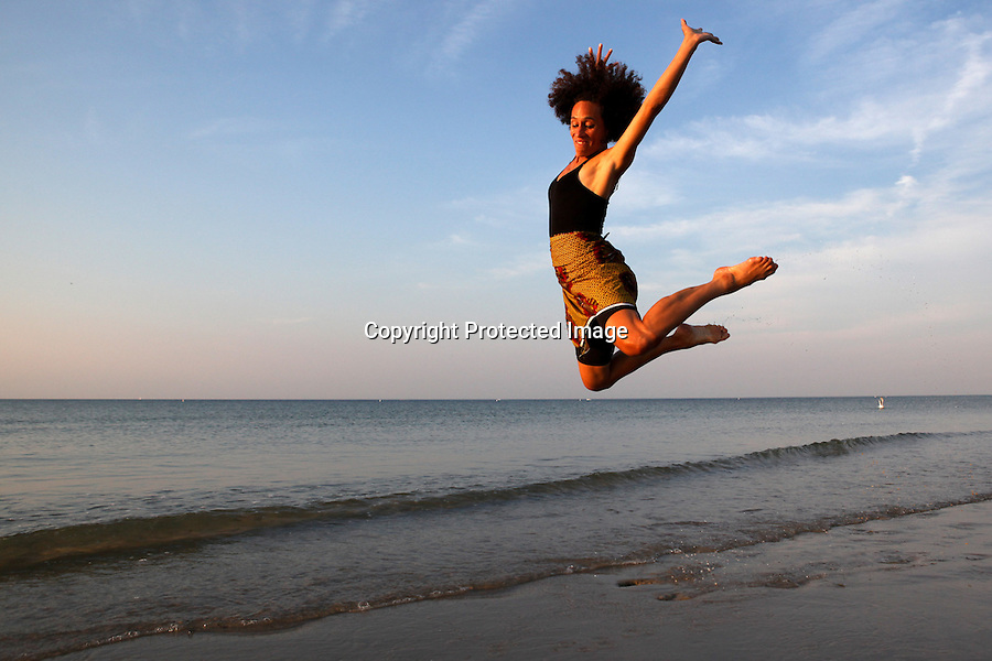 African dancer, Tara Murphy, is photographed dancing at Cold Storage Beach in Dennis, MA. ?My greatest hope with teaching dance is to offer people that glimpse of inner freedom we're all born with-the spark of divinity within us,? says Murphy.