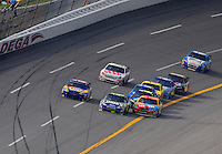 Apr 27, 2008; Talladega, AL, USA; NASCAR Sprint Cup Series driver Kyle Busch (18) goes below the yellow line to pass Jimmie Johnson (48) during the Aarons 499 at Talladega Superspeedway. Mandatory Credit: Mark J. Rebilas-