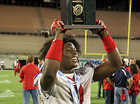 Manatee Hurricanes running back Leon Allen #7 hoists the Championship trophy after the Florida High School Athletic Association 7A Championship Game at Florida's Citrus Bowl on December 16, 2011 in Orlando, Florida.  Manatee defeated First Coast 40-0.  (Mike Janes/Four Seam Images)