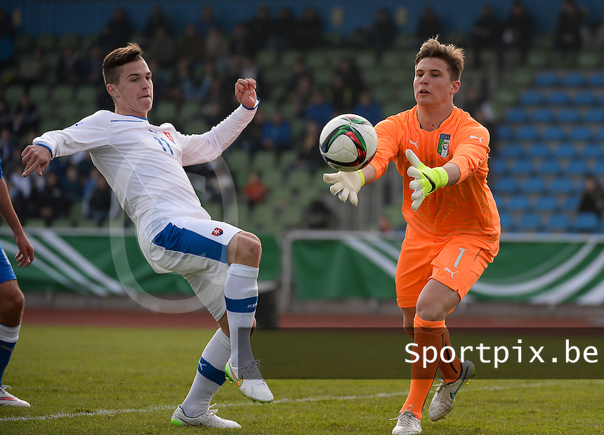 20150323 - MARBURG , GERMANY  : Italian goalkeeper Alex Rizzotto (right) pictured intercepting a ball in front of Slovakian attacker Lubomir Tupta (left) during the soccer match between Under 17 teams of Slovakia and Italy , on the second matchday in group 8 of the UEFA Elite Round Under 17 at Georg-Gassmann , Marburg Germany . Monday 23 rd  March 2015 . PHOTO DAVID CATRY