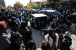 Mourners gather around the hearse carrying the casket of Tyshawn Lee, 9, who was shot multiple times while playing basketball in an alley on November 2, 2015, outside St. Sabina's Church following Lee's funeral in Chicago, Illinois on November 10, 2015. Police allege the killing was a retaliatory gang hit which would mark a new turn in Chicago's gang wars.