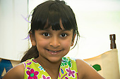 MR / Schenectady, NY. Zoller Elementary School (urban public school). Kindergarten classroom. Portrait of student (girl, 6, biracial) in class. MR: Myk1. ID: AM-gKw. © Ellen B. Senisi.