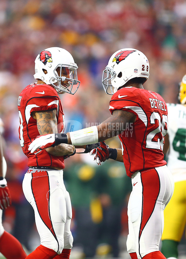 Dec 27, 2015; Glendale, AZ, USA; Arizona Cardinals wide receiver Brittan Golden (left) with cornerback Justin Bethel against the Green Bay Packers at University of Phoenix Stadium. Mandatory Credit: Mark J. Rebilas-USA TODAY Sports