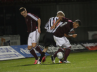 Jack Smith sandwiched between Jamie Walker (left) and Callum Tapping in the St Mirren v Heart of Midlothian Clydesdale Bank Scottish Premier League U20 match played at St Mirren Park, Paisley on 6.11.12.