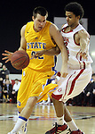 VERMILLION, SD - FEBRUARY 9: Jordan Dykstra #42 from South Dakota State tries to drive past the defense of Allen Saint-Gelais #22 from the University of South Dakota in the first half of their game Thursday night at the DaktaDome in Vermillion, SD. (Photo by Dave Eggen/Inertia)