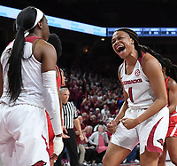 NWA Democrat-Gazette/J.T. WAMPLER Arkansas' Raven Northcross-Baker (RIGHT) and Malica Monk celebrate in the final minute against Houston Thursday March 21, 2019 at Bud Walton Arena in Fayetteville during the first round of the Women's National Invitational Tournament. Arkansas won 88-80 in overtime. The Razorbacks take on University of Alabama at Birmingham at home on Sunday.