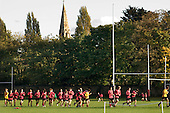 Rugby training on playing fields in Cricklewood, London, belonging to University College School for Boys. UCS is a private, fee-paying school.