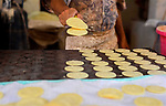 An Egyptian vendor prepares traditional pancakes known as ''Qatayef'' on the Muslim holy fasting month of Ramadan at market in Cairo, Egypt, on June 10, 2017. Ramadan is sacred to Muslims because it is during that month that tradition says the Koran was revealed to the Prophet Mohammed. The fast is one of the five main religious obligations under Islam. More than 1.5 billion Muslims around the world will mark the month, during which believers abstain from eating, drinking, smoking and having sex from dawn until sunset. Photo by Amr Sayed