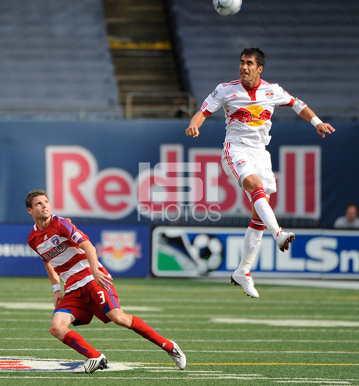 Juan Pablo Angel (9) of the New York Red Bulls heads the ball as Drew Moor (3) of FC Dallas watches. The New York Red Bulls defeated FC Dallas 3-2 during a Major League Soccer match at Giants Stadium in East Rutherford, NJ, on August 23, 2009.