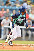 Asheville Tourists Daniel Montano (24) swings at a pitch during a game against the Greenville Drive on Hippie Night at McCormick Field on July 11, 2019 in Asheville, North Carolina. The Drive defeated the Tourists 6-2. (Tony Farlow/Four Seam Images)
