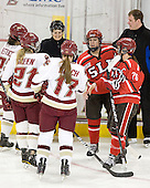 Mary Restuccia (BC - 22), Andrea Green (BC - 21), Julie Piacentini, Danielle Welch (BC - 17), Josee Belanger (SLU - 4), Karell Emard (SLU - 76), Bill Doiron - The Boston College Eagles defeated the visiting St. Lawrence University Saints 6-3 (EN) in their NCAA Quarterfinal match on Saturday, March 10, 2012, at Kelley Rink in Conte Forum in Chestnut Hill, Massachusetts.