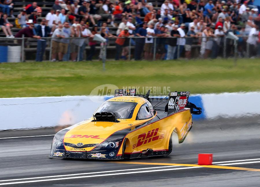 May 31, 2014; Englishtown, NJ, USA; NHRA funny car driver Del Worsham during qualifying for the Summernationals at Raceway Park. Mandatory Credit: Mark J. Rebilas-