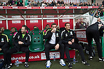 Home team manager Alan Stubbs sipping a drink at Easter Road stadium before the kick-off in the Scottish Championship match between Hibernian and visitors Alloa Athletic. The home team won the game by 3-0, watched by a crowd of 7,774. It was the Edinburgh club's second season in the second tier of Scottish football following their relegation from the Premiership in 2013-14.
