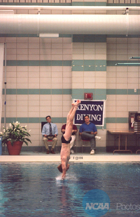 Caption: John Butcher of Kenyon glides into the water during the 3 meter dive in the Division III Men's Swimming Competition March 18, 1995, in Oxford, Ohio. Butcher won the event with a total of 205.15 points. Patrick Reddy/NCAA photos.